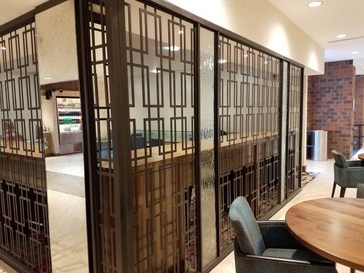 Tableaux Decorative Grille Partitions Separate the Café area in the Hilton Dedham