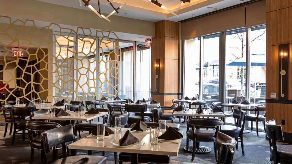 Tableaux grille provides visual interest with this elegant, contemporary divider in the main dining room of TRIS Restaurant